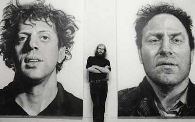Chuck Close between his works