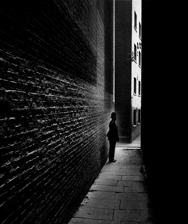 Policeman in a Bermondsey Alley, 1938